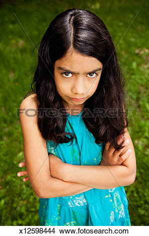 Stock Photo of Angry girl with wide, brown eyes, portrait.