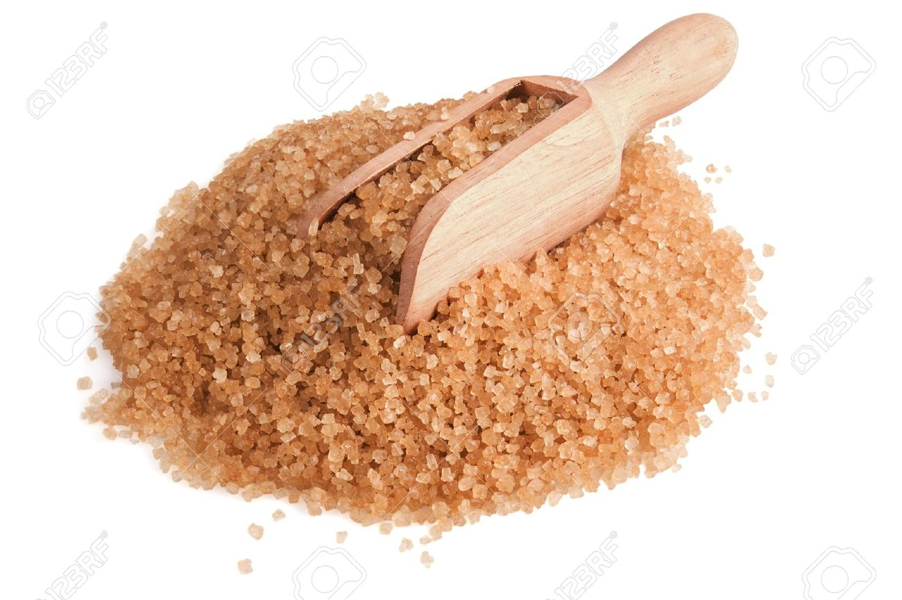 heap of brown sugar and wooden scoop on white background.