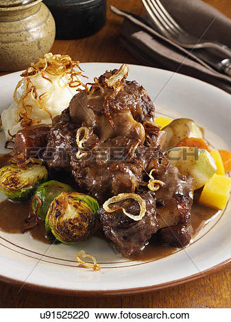 Stock Photography of Oxtail casserole with turnips carrots.