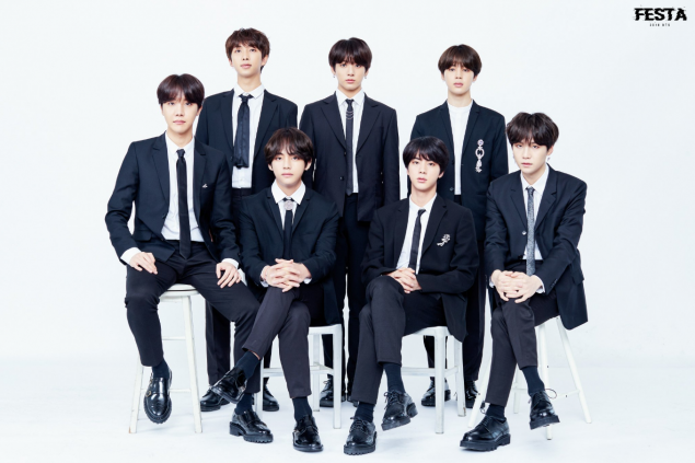 BTS suit up in their traditional family photo for '2018 BTS FESTA.