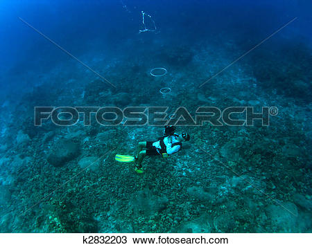 Stock Photo of Divemaster Blowing Bubble Rings k2832203.