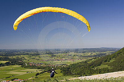 Yellow Canopy Paraglider Stock Photos, Images, & Pictures.