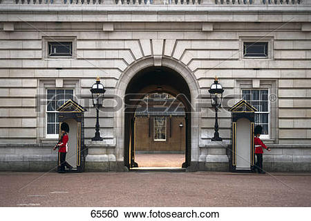 Stock Photography of Palace guards at archway entrance of palace.