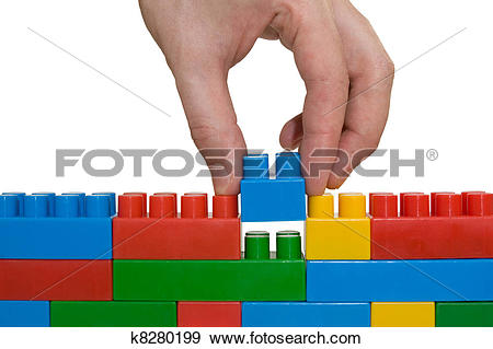 Stock Photograph of hand building up lego wall k8280199.