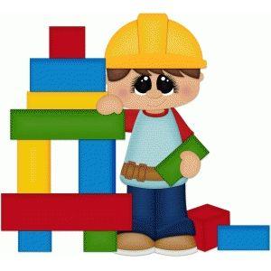 Boy playing w building blocks.