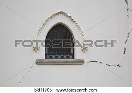 Stock Photography of Window in a Cracked Building Wall bld117051.