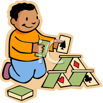 Ethnic Boy Building a House of Cards.