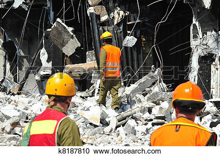 Stock Photography of Search and Rescue Through Building Rubble.
