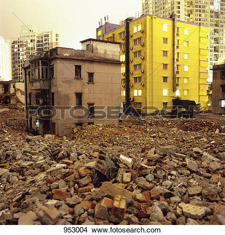 Stock Photo of Old dilapidated buildings and rubble with modern.