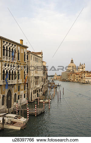 Stock Images of Buildings and boats on canal in Venice, Italy.