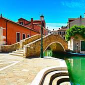 Stock Image of Venice cityscape, narrow water canal, bridge, boats.