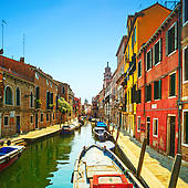 Picture of Venice cityscape, narrow water canal, campanile church.