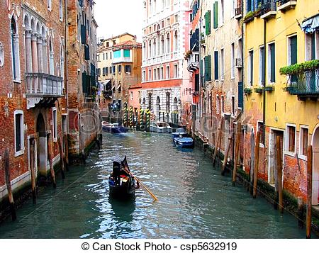 Stock Photographs of Colorful Buildings on a canal in Venice.