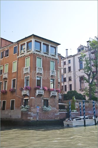 An old apartment building on a canal in venice, italy, italian.