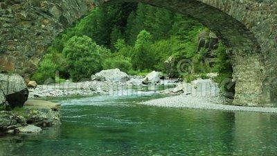 Rio Ara River And Bridge San Nicolas De Bujaruelo In Ordesa Aragon.