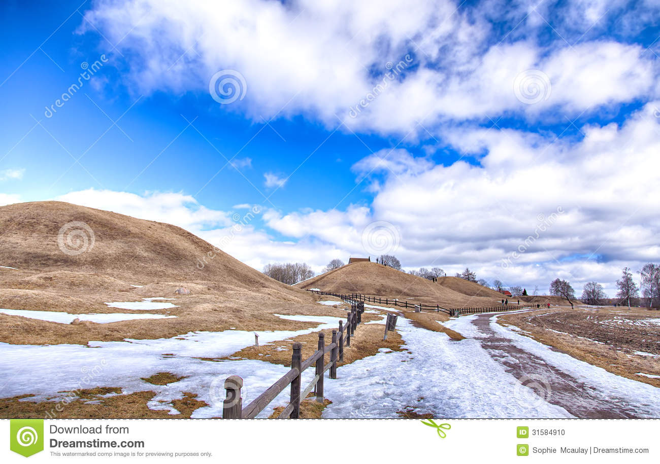 Old Uppsala Burial Mounds And Medieval Church Stock Photos.