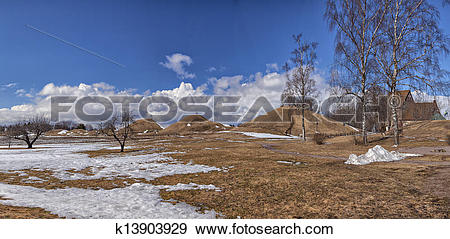 Stock Photograph of Old Uppsala burial mounds and medieval church.