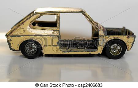 Stock Photos of Old abandoned burned car isolated over white.