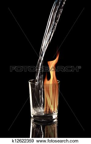 Stock Photograph of Pouring alcohol into a burning cocktail glass.