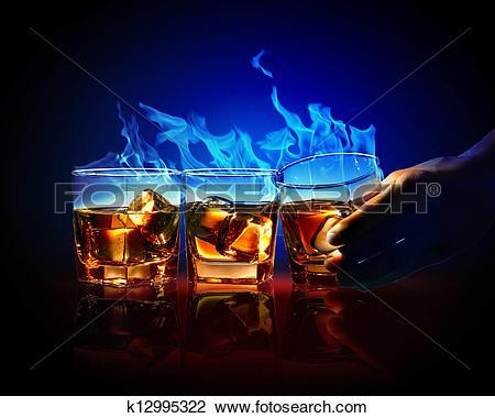 Clip Art of Three glasses of burning yellow absinthe k12995322.