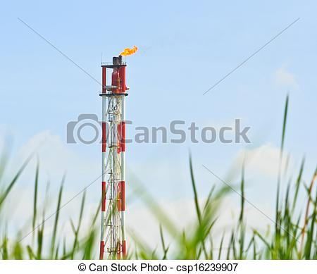 Stock Photography of Smokestack burning flare in the petrochemical.