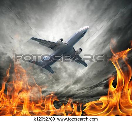Stock Photograph of Airplane flying over burning sky k12052789.