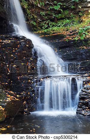 Stock Photo of Autumn Waterfall in mountain from Bushkill Falls.