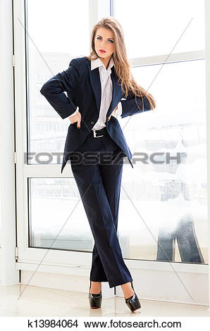 Stock Photo of Young business woman looking bossy wearing man's.