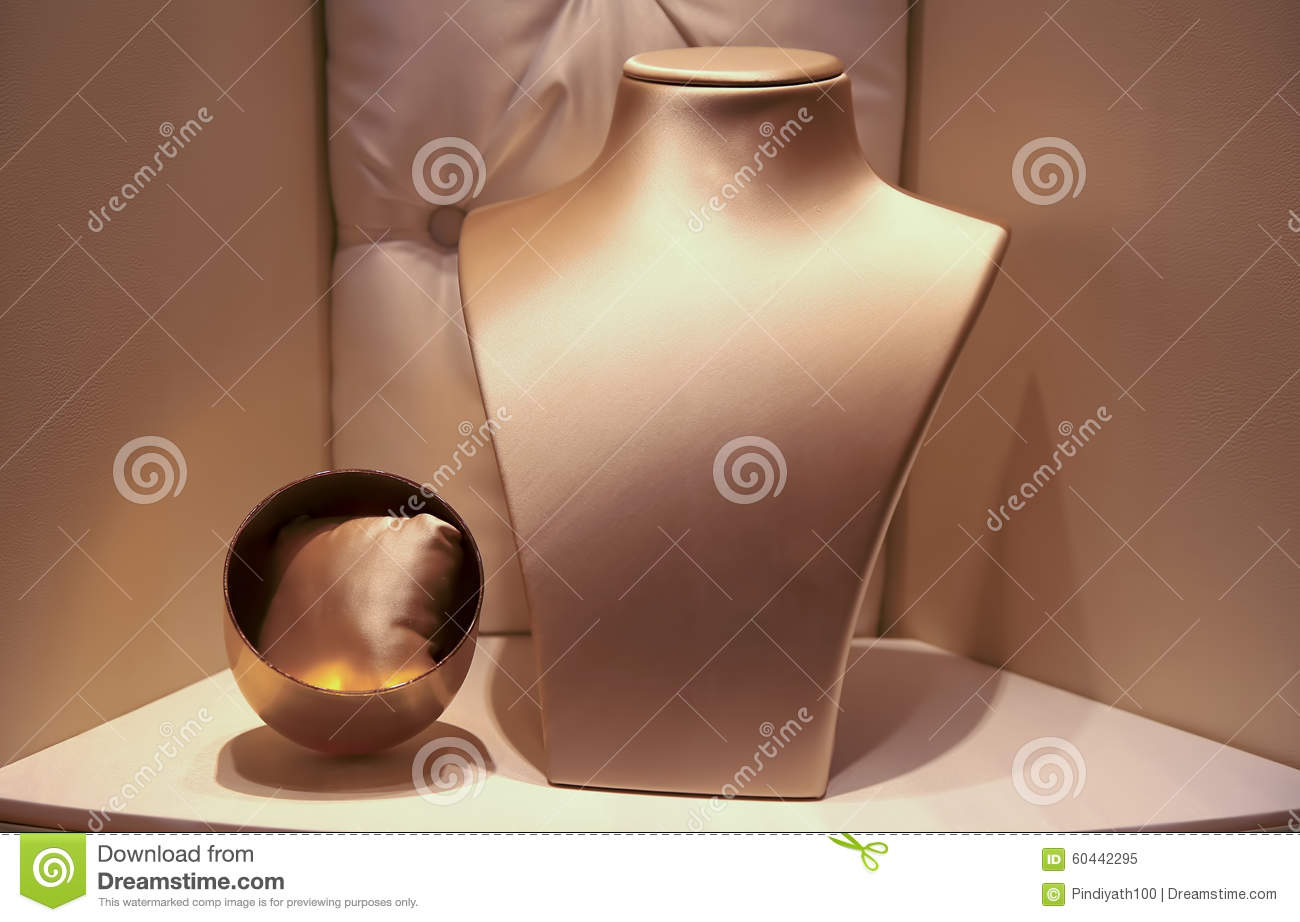 Empty Boutique Window With Jewelry Bust Stock Photo.