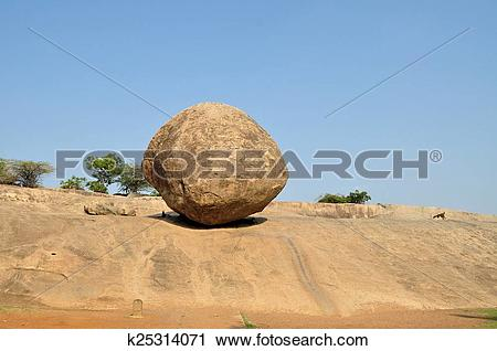 Stock Photography of Krishna's butterball balancing giant rock.