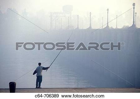 Stock Photograph of Young man fishing. Nile Delta. Egypt c64.