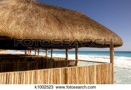 Stock Photo of Bamboo Cabanas on the Beach k1002523.