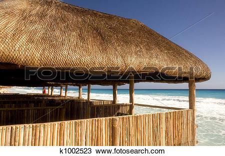 Stock Photo of Bamboo Cabanas on the Beach k1002523.