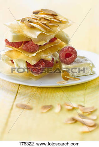 Stock Photo of Cabécou cheese,raspberry and thinly sliced almond.