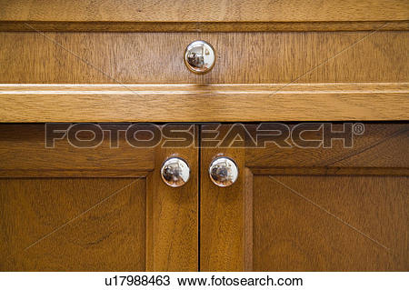 Stock Photo of Detail of three chrome cabinet knobs. u17988463.