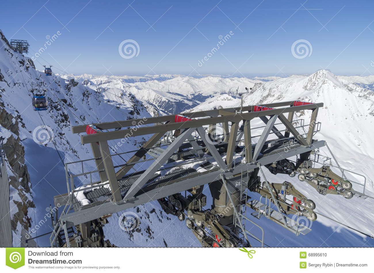 Cable Car Masts On A Steep Slope. Austrian Alps. Stock Photo.
