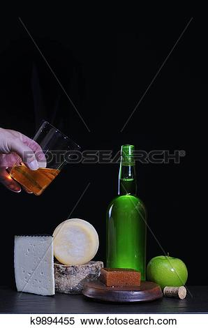 Stock Image of Asturian cider and Cabrales cheese. k9894455.