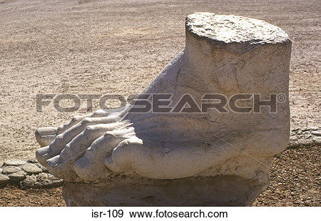 Stock Photograph of Marble Foot from Roman Statue Caesarea Israel.