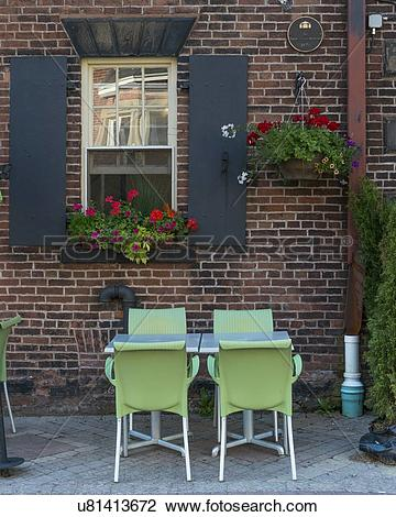 Stock Photo of Sidewalk cafe in front of a building, Queens Square.