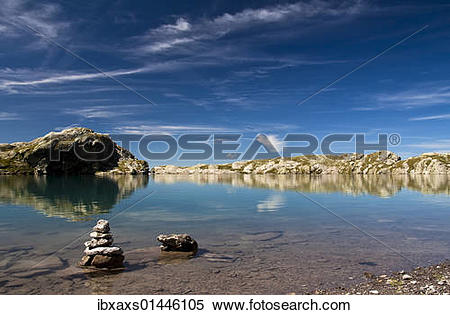 """Stock Image of """"Cairns in the Schottensee lake below the Pizol."""
