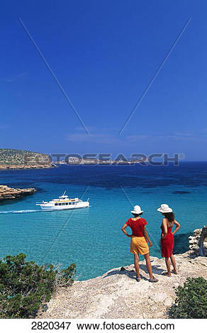 Picture of Two people standing on cliff, Cala Comte, Ibiza.