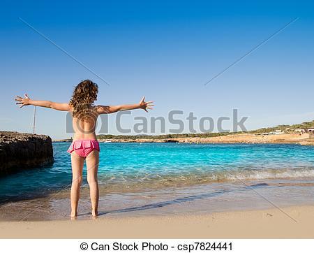 Stock Photography of Ibiza Cala Conta beach open arms little girl.