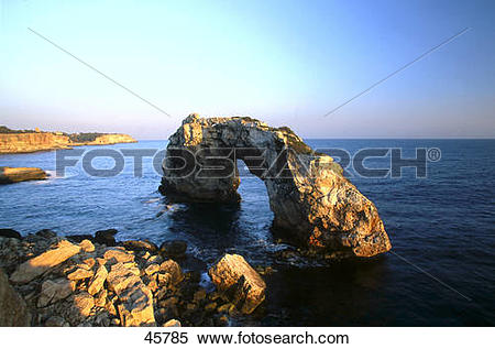 Stock Image of Rock formations in sea, Pontas, Cala Santanyi.