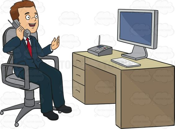 Man Sitting At A Desk Talking On The Phone.
