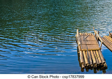 Stock Photographs of Bamboo raft floating on blue calm water in.