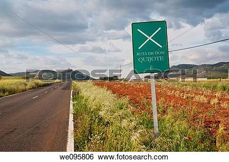 Stock Images of Don Quijote's route signpost and road. Calzada de.
