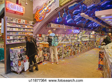 Stock Photo of England, London, Camden. People browsing CDs for.