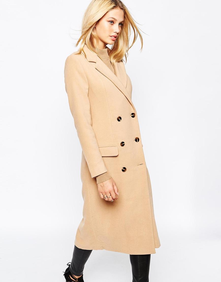 Tamara Ecclestone looks chic in camel coat alongside daughter.