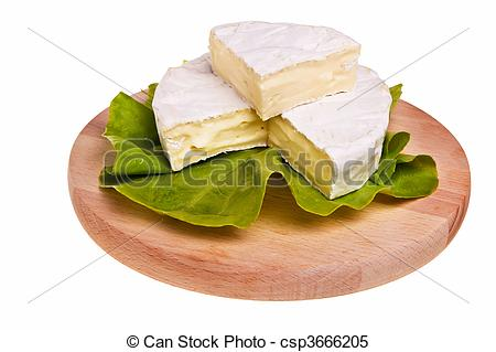 Stock Images of Round camembert cheese on lettuce on cutting board.