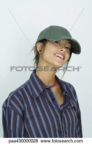 Pictures of Teenage girl wearing cap, smiling at camera, portrait.